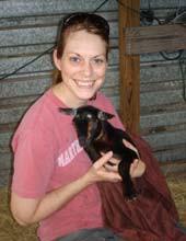 Kelli with pet goat, Roscoe