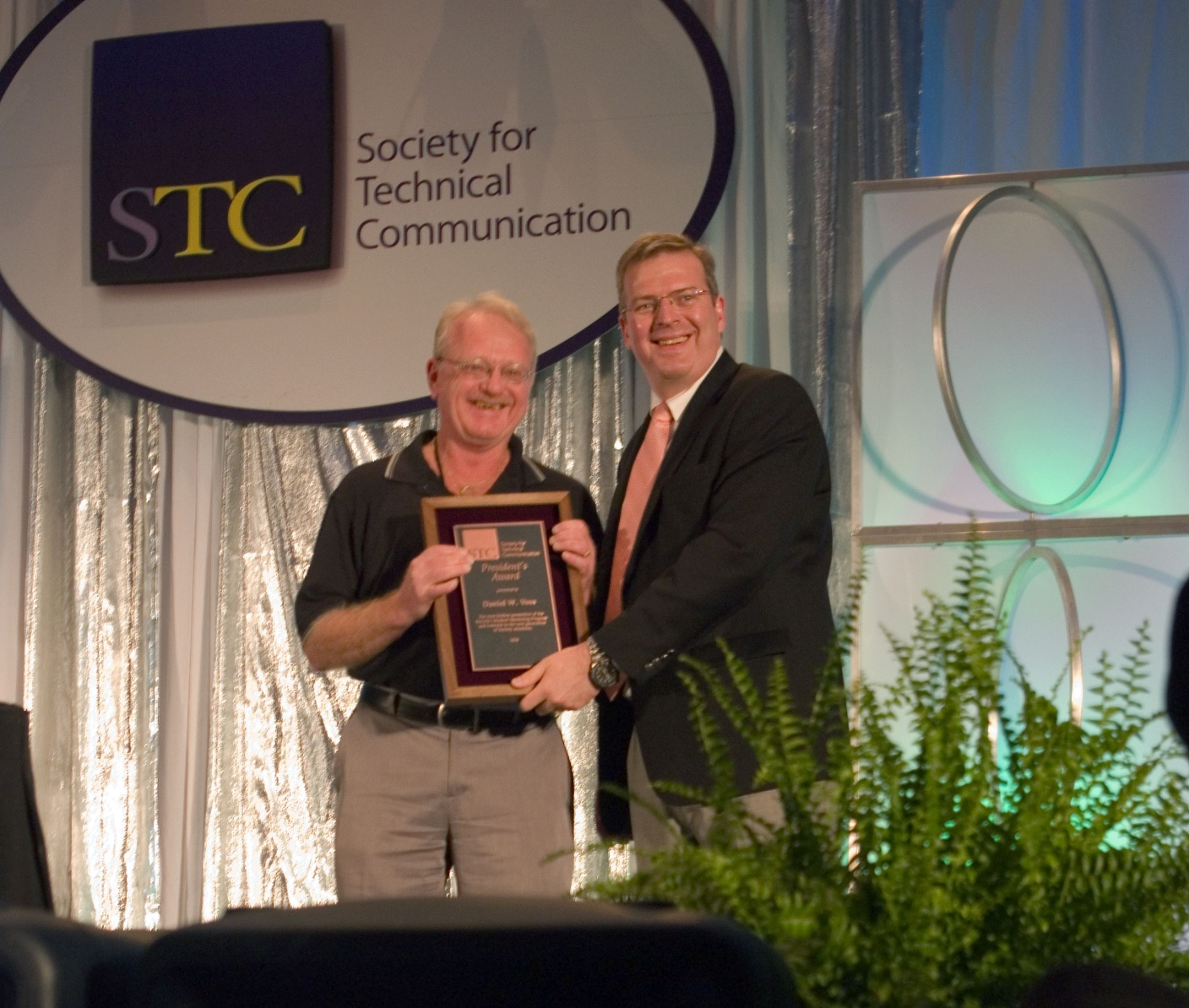 Dan Voss receives the STC President's Award onstage at the Summit.